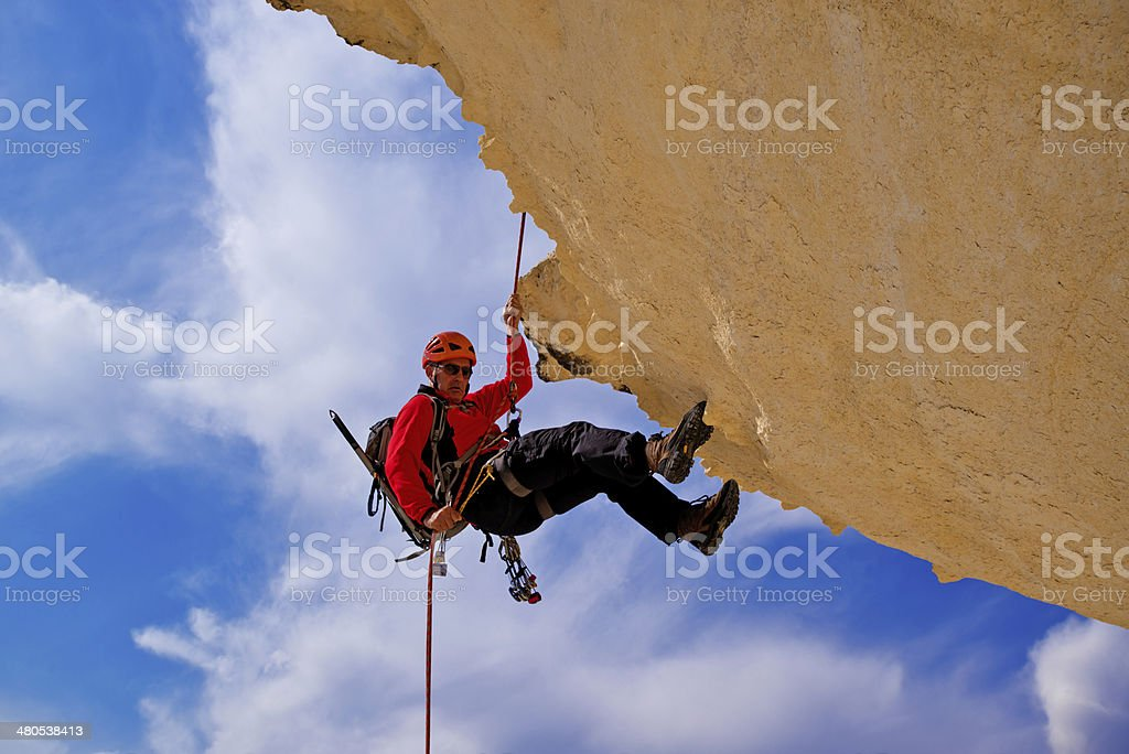 Climbing a mountain stock photo