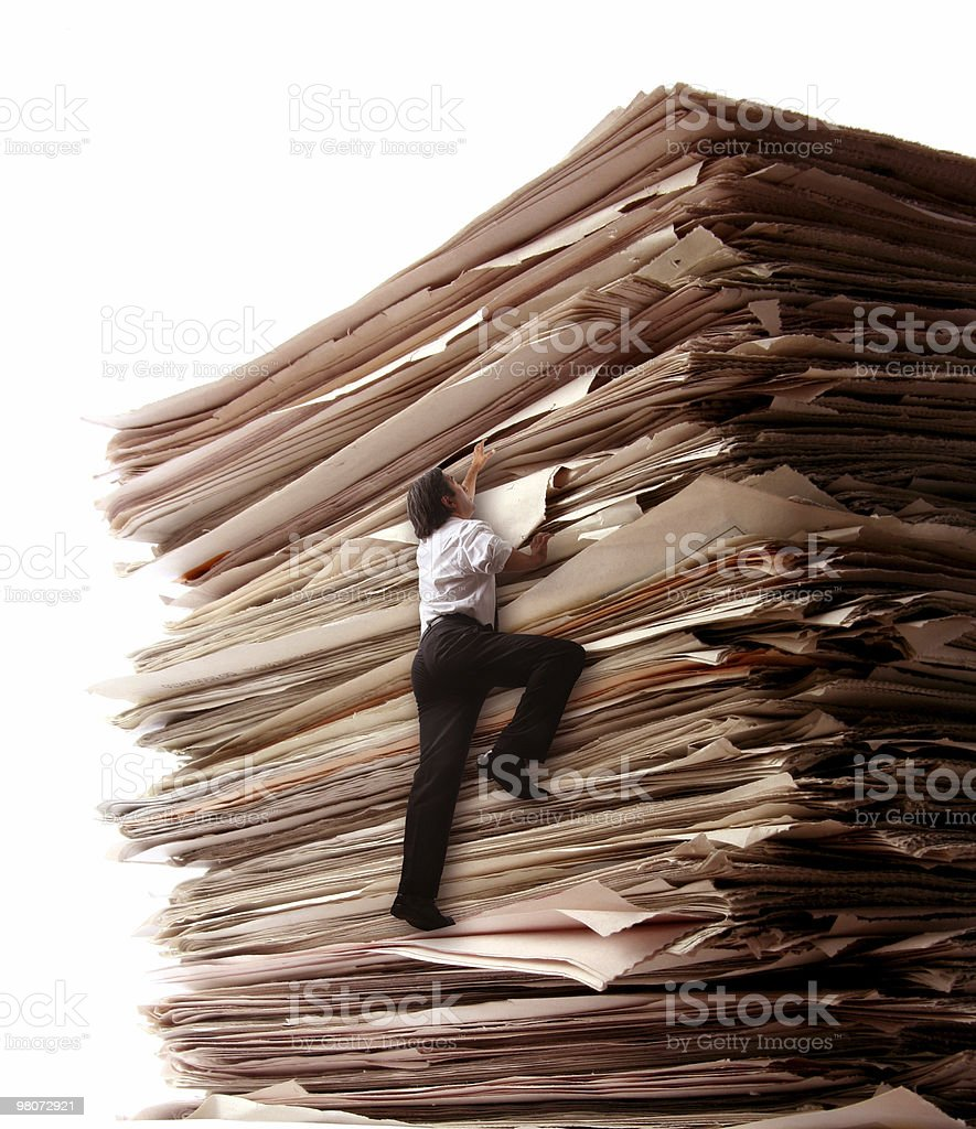 Climbing a Pile of Files stock photo