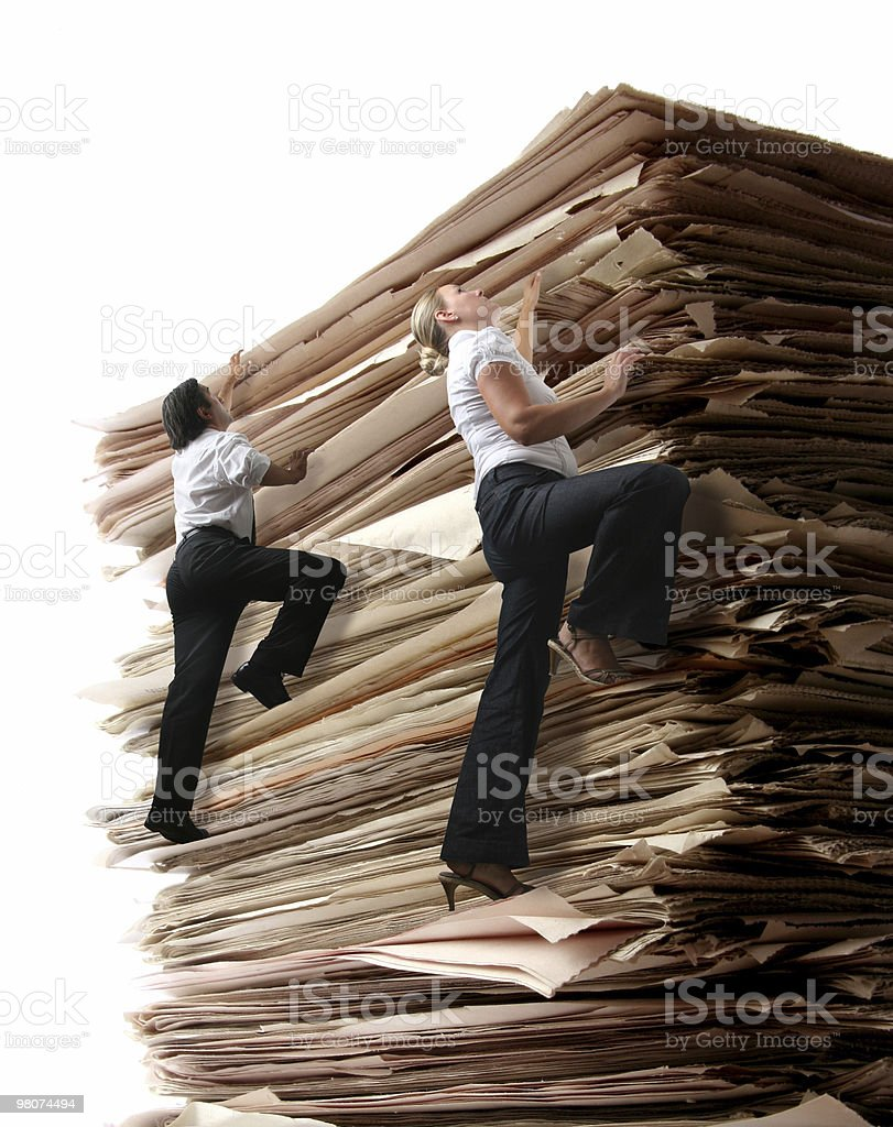 Climbing a pile of Files royalty-free stock photo