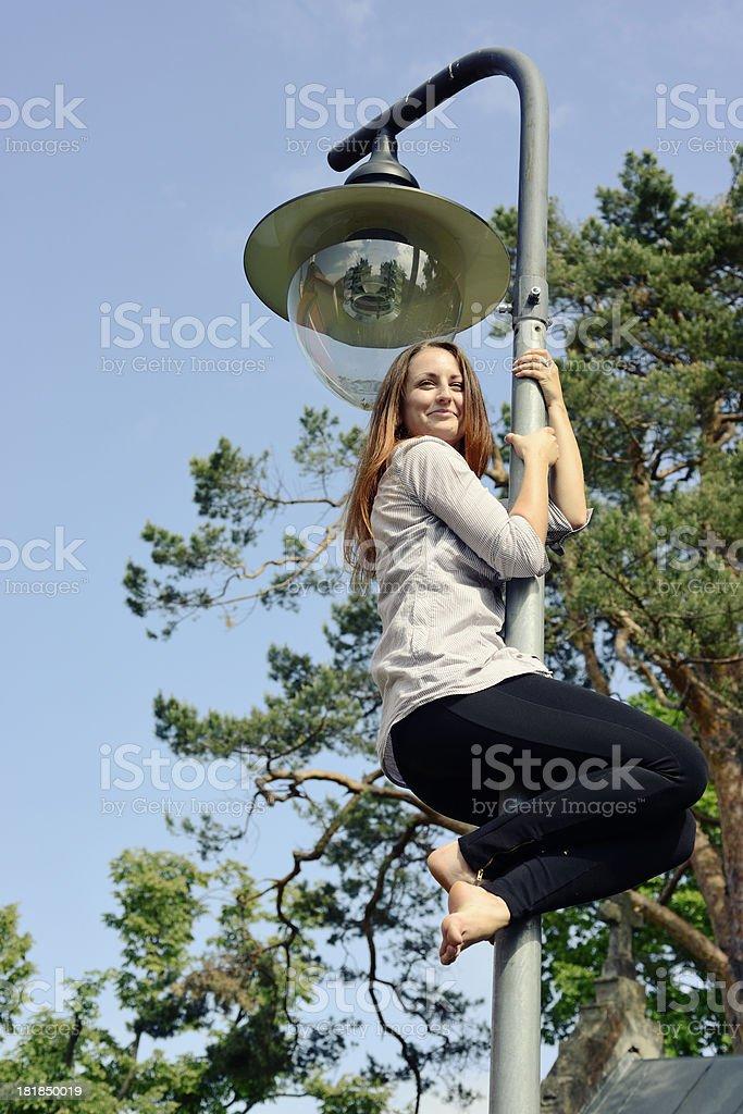 Climbing a street lamp royalty-free stock photo