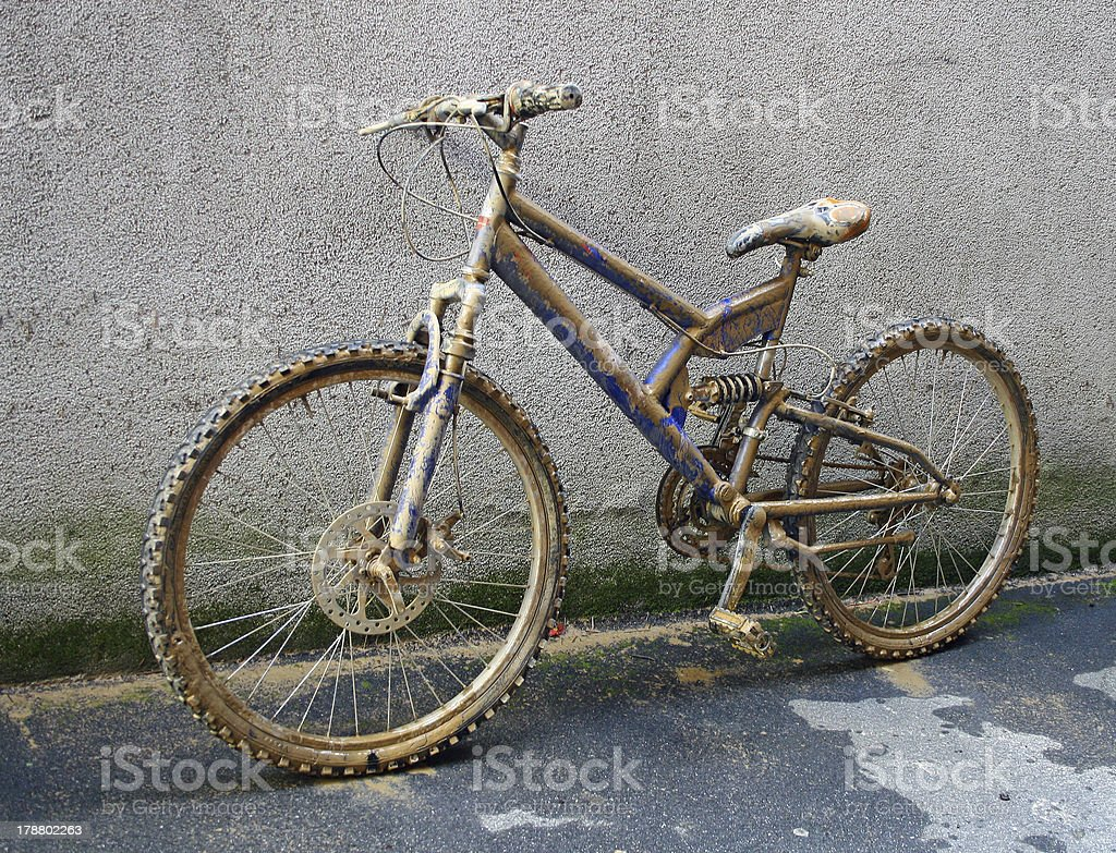 climbing bike completely covered with brown mud and sprinkles royalty-free stock photo