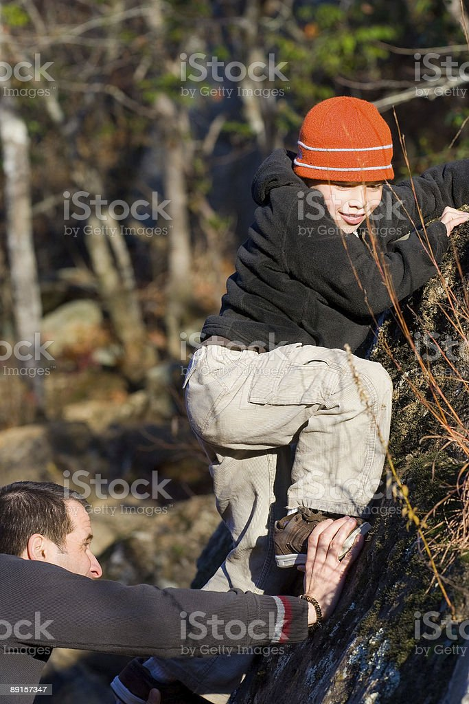 Climbing boy with help of father royalty-free stock photo