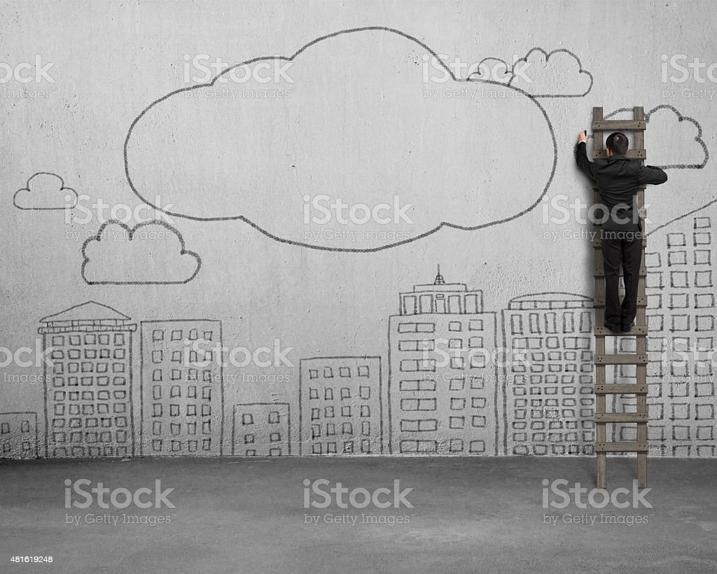Climbing businessman drawing clouds with copy space on concrete stock photo