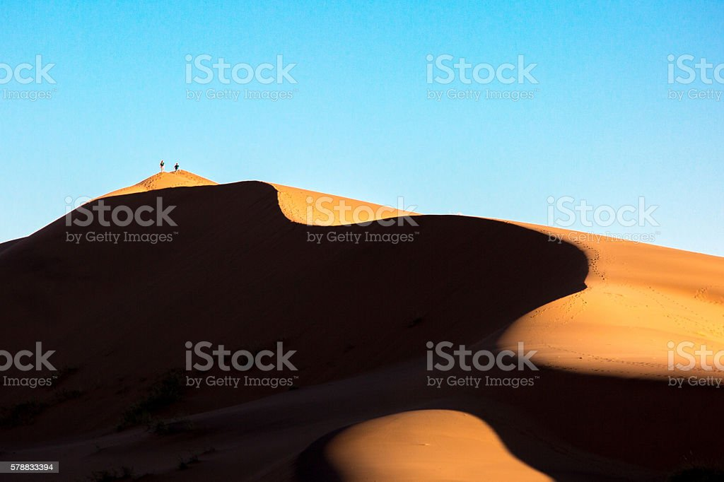 Climbing desert sand dune stock photo