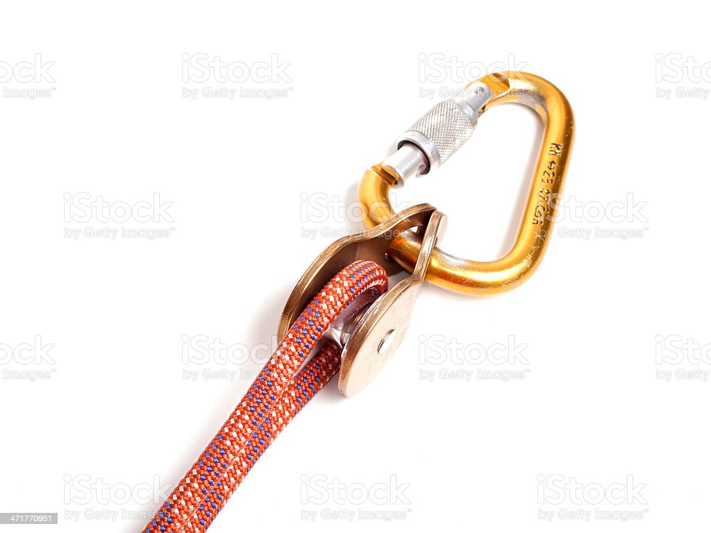 Climbing equipment - pulley, rope, carabiner royalty-free stock photo