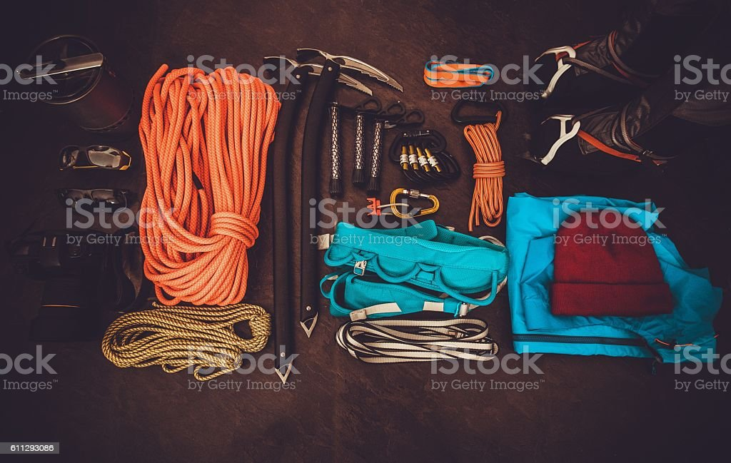 Climbing equipment set on dark background Travel lifestyle stock photo