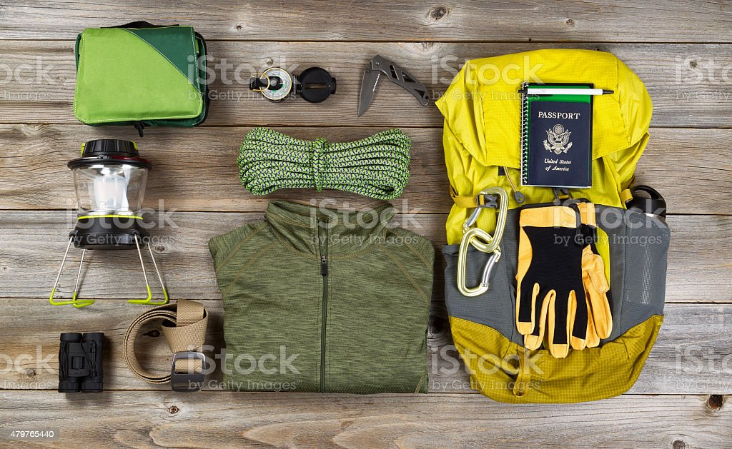 Climbing gear for hiking on rustic wooden boards stock photo