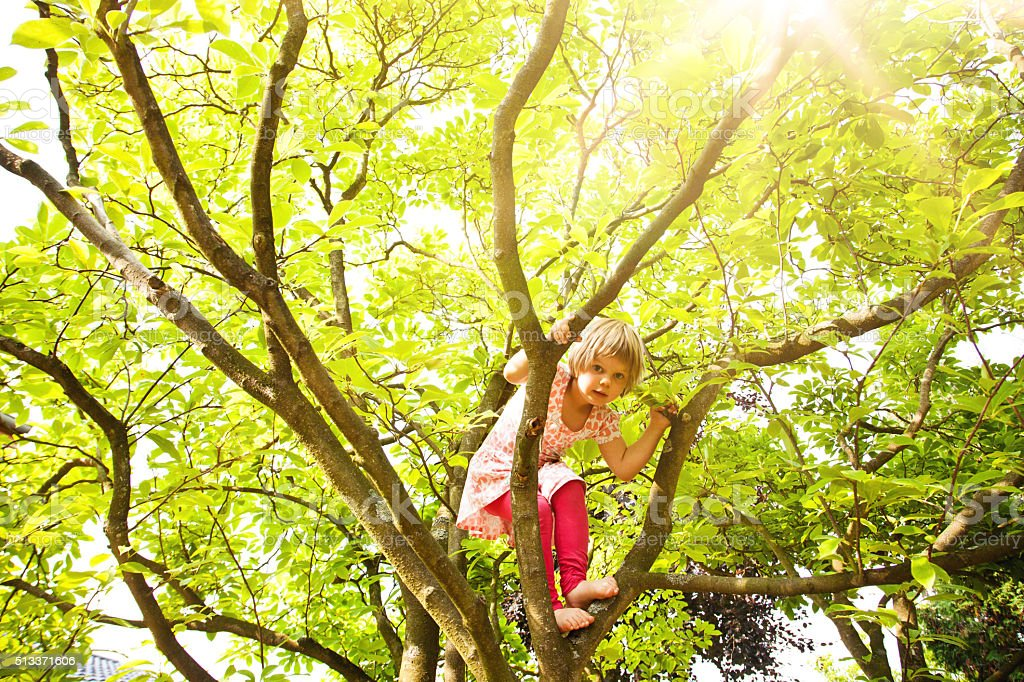 Climbing girl stock photo