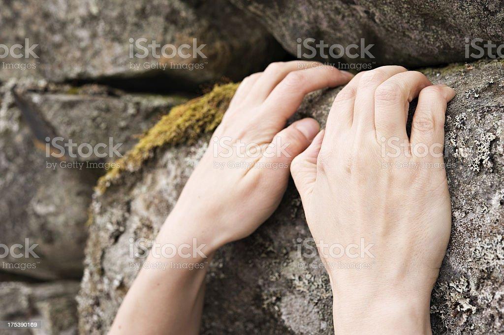 Climbing hand grip on rock stock photo