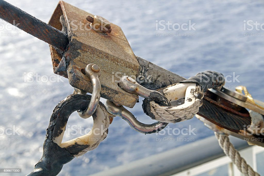 Climbing harness rigged on a carabiner in trade ship stock photo