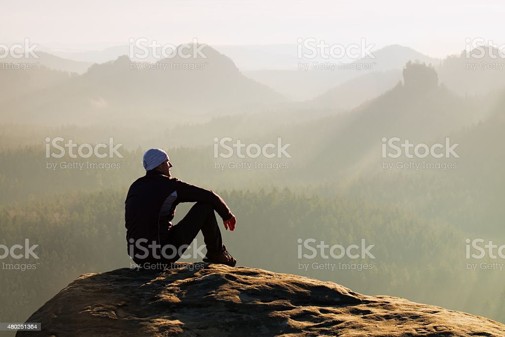 Climbing man at top of  rock with beautiful  aerial view stock photo