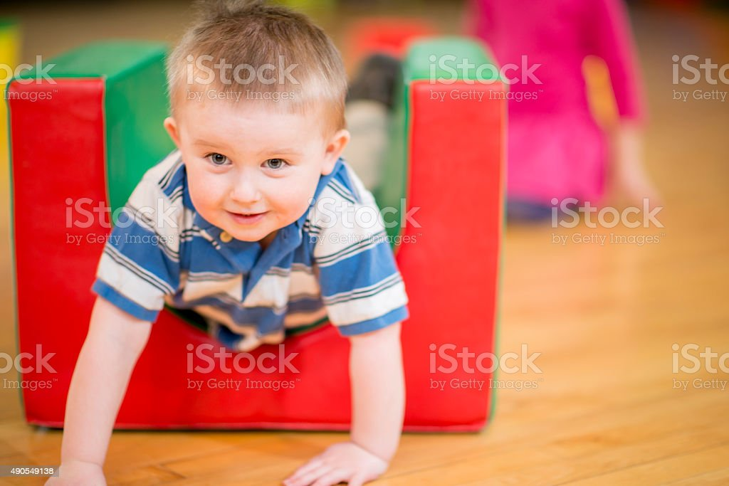 Climbing on Mats in the Gym stock photo