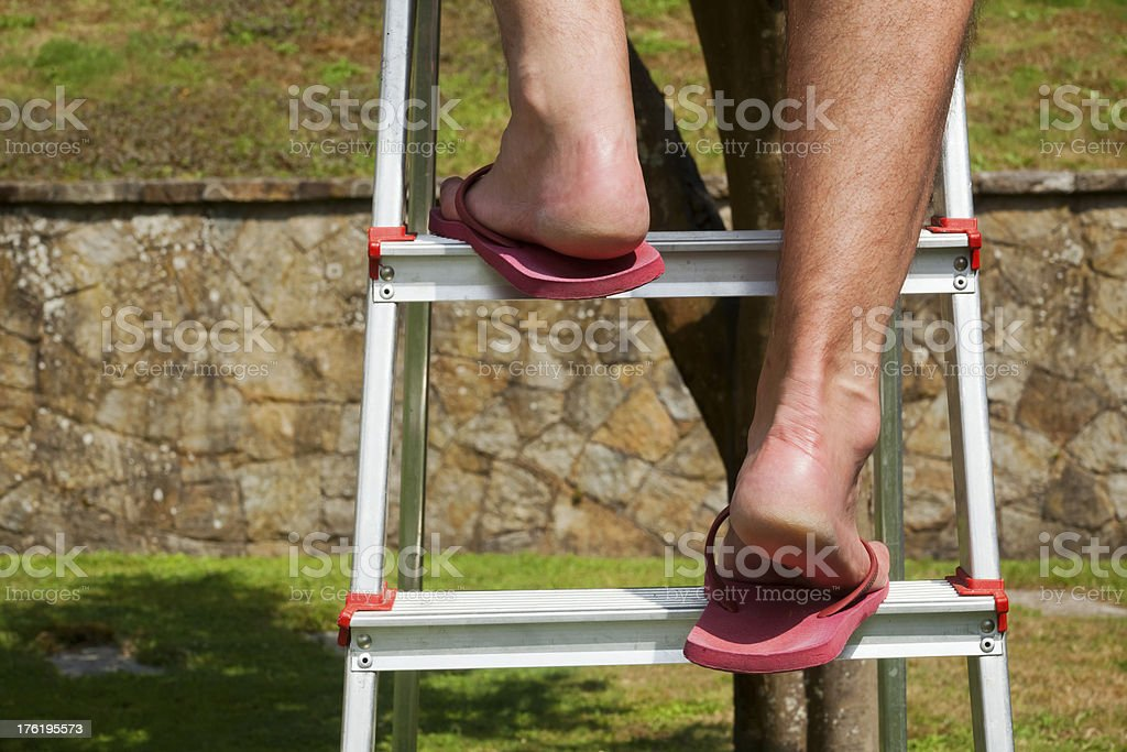 Climbing on step ladder royalty-free stock photo