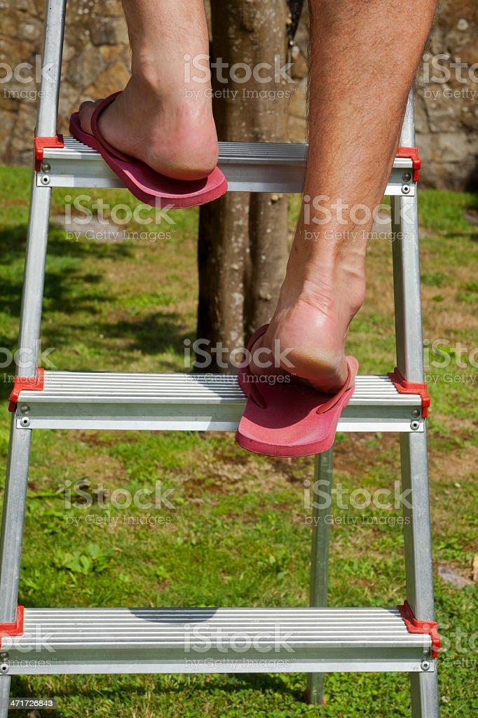 Climbing on step ladder royalty-free stock photo