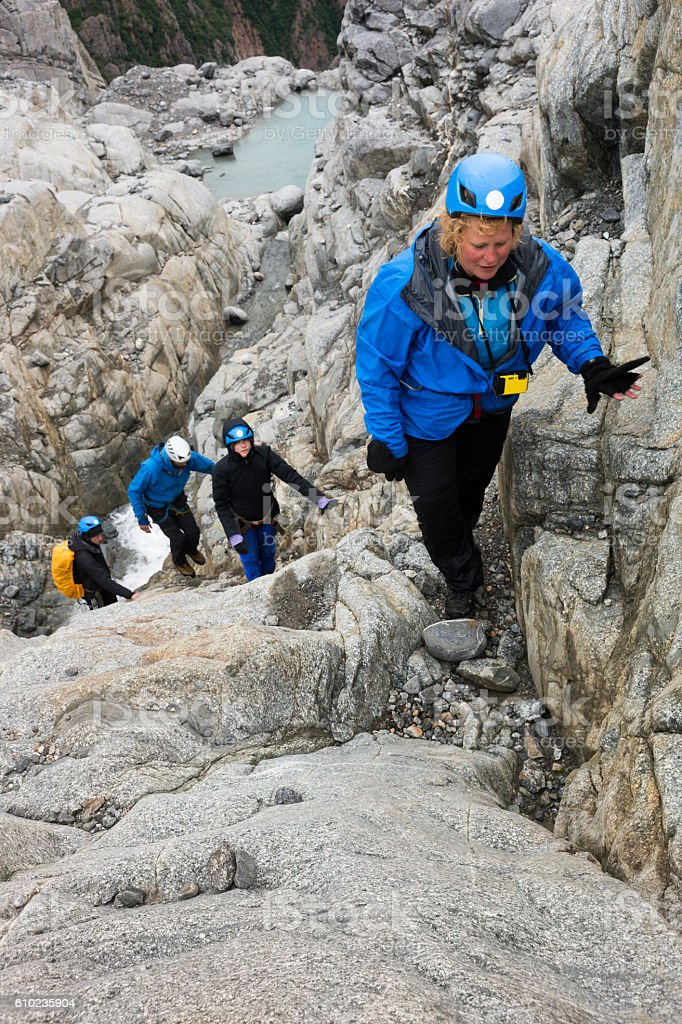Climbing over rocks in Alaska stock photo