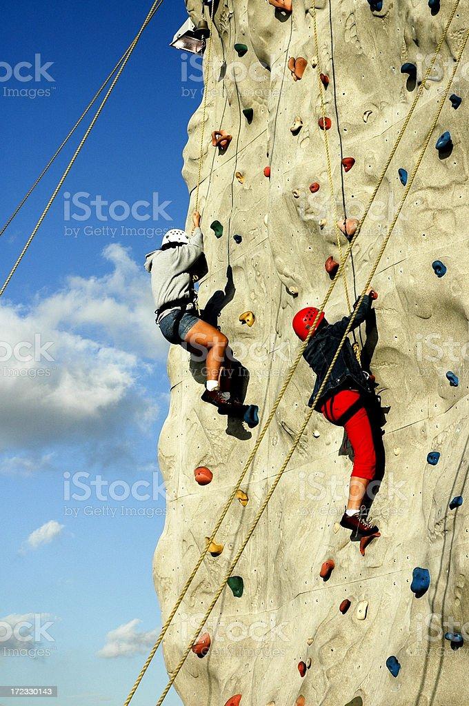 Climbing rock wall stock photo