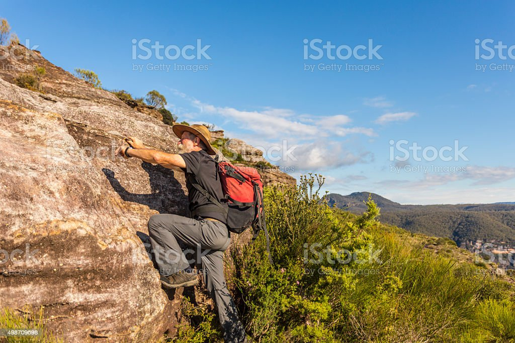 Climbing Senior Man Bushwalker in Spectacular Landscape stock photo