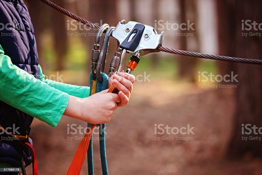 Climbing Sports Image Of A Carabiner On A Metal Rope stock photo
