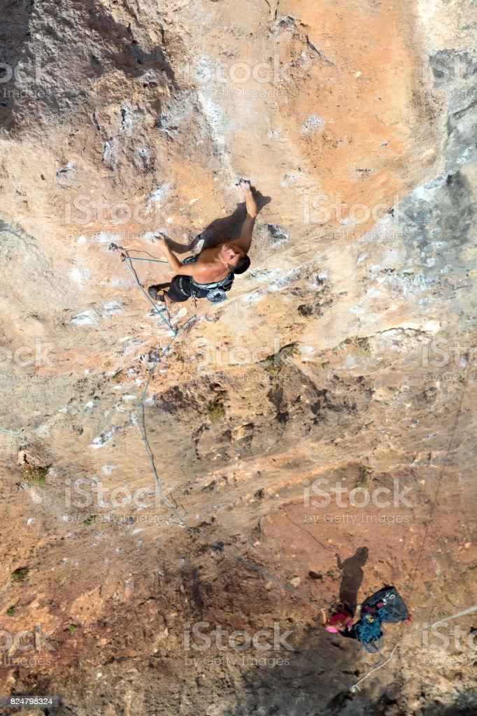Climbing Team ascending vertical Rock Wall top View stock photo