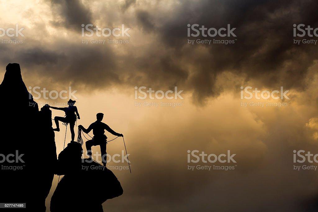Climbing team on the edge. stock photo