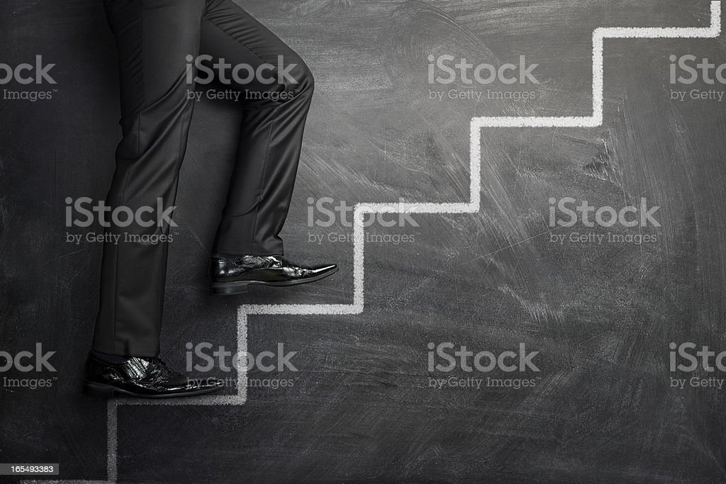 Climbing the career stairs stock photo