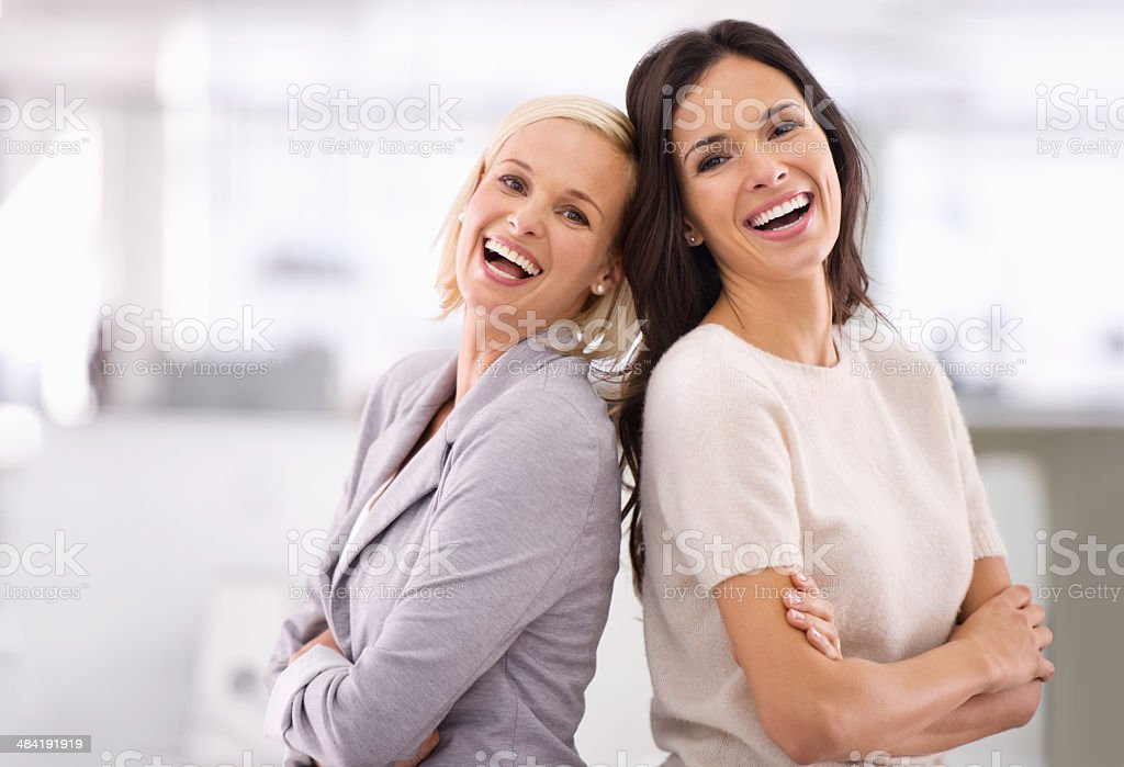 Climbing the corporate ladder is easier with a friend stock photo