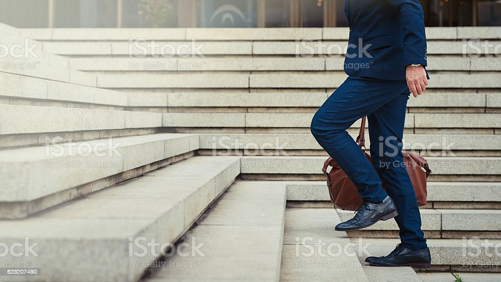 Climbing the steps to success stock photo
