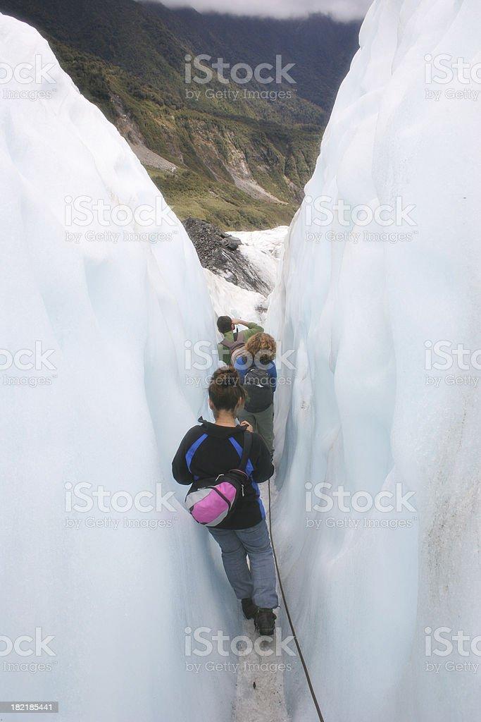 Climbing Through an Ice Crevice stock photo
