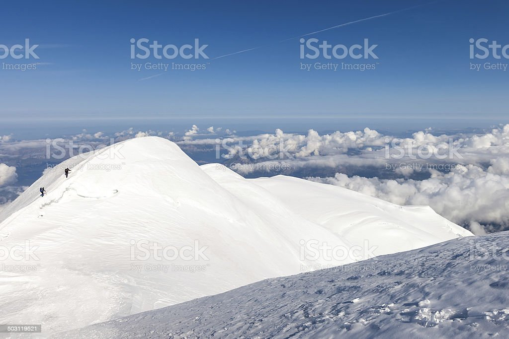 climbing to the top of Mont Blanc stock photo