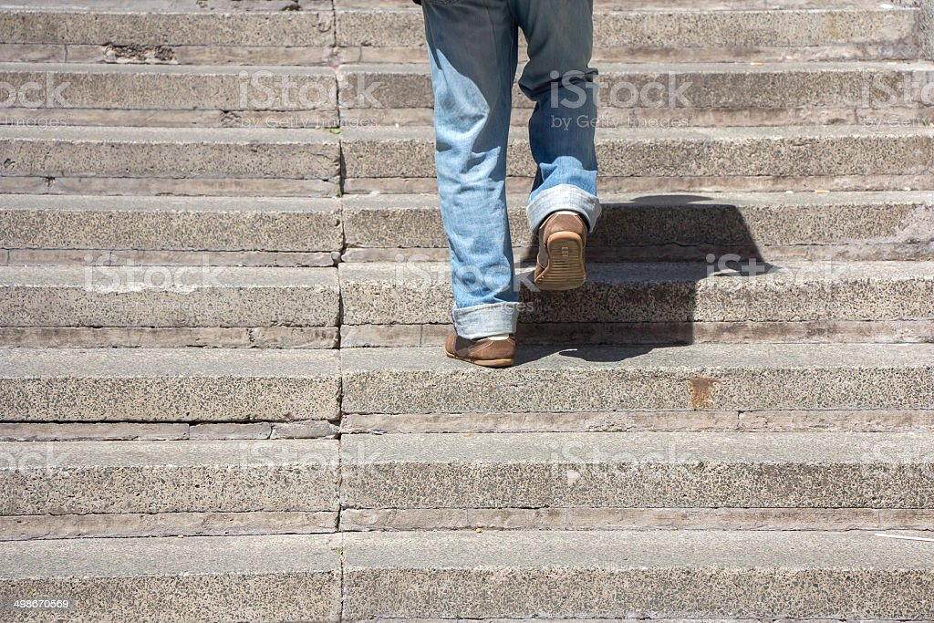 Climbing up stairs stock photo