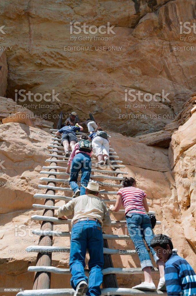 Climbing up to a cliff dwelling Mesa Verde, National Park, Colorado stock photo
