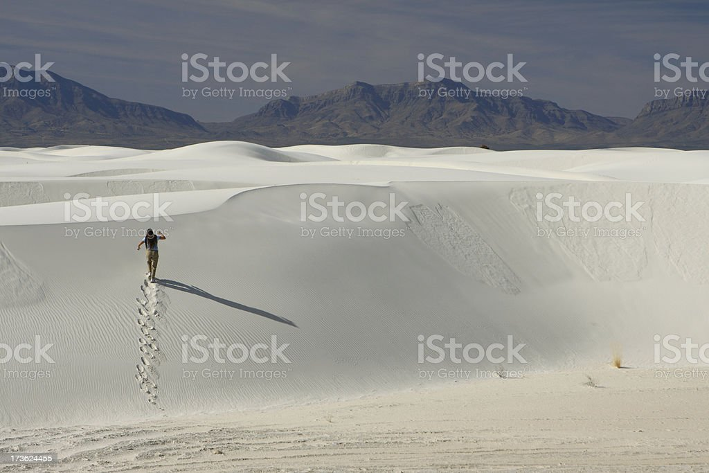 Climbing White Sands, NM stock photo