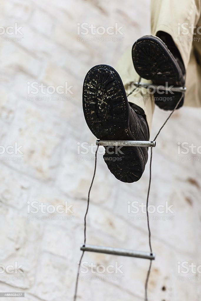 Climbing with boots stock photo