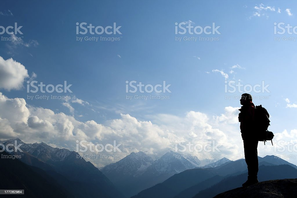 Climbing young adult at the top of summit royalty-free stock photo
