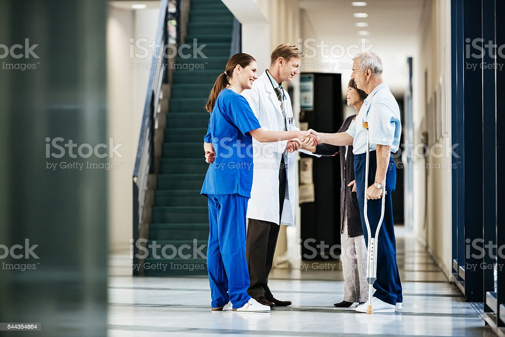 Clinic Staff Welcomes Patients stock photo