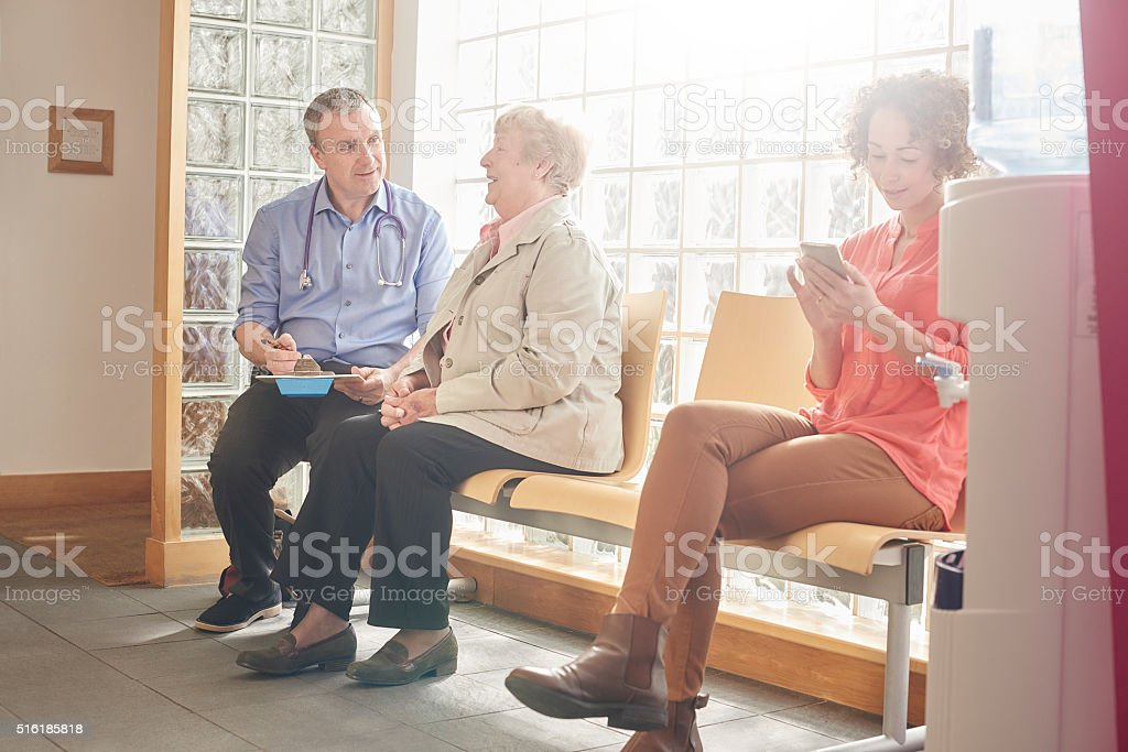 Clinic visit for senior woman stock photo