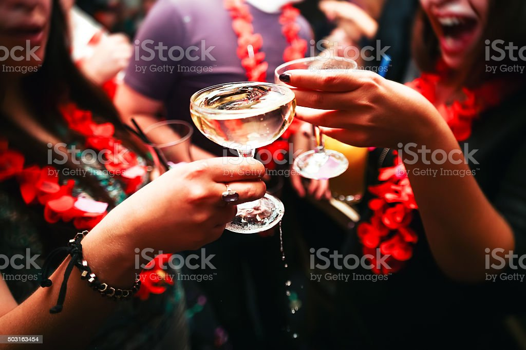Clinking glasses and toasting stock photo