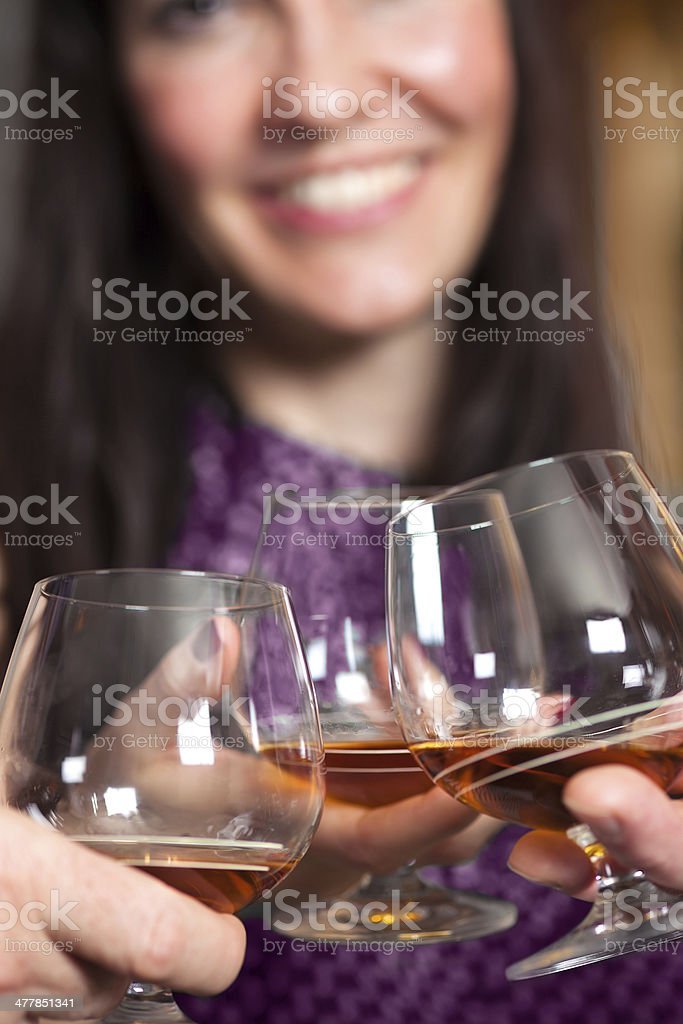 Clinking glasses with fine brandy. royalty-free stock photo