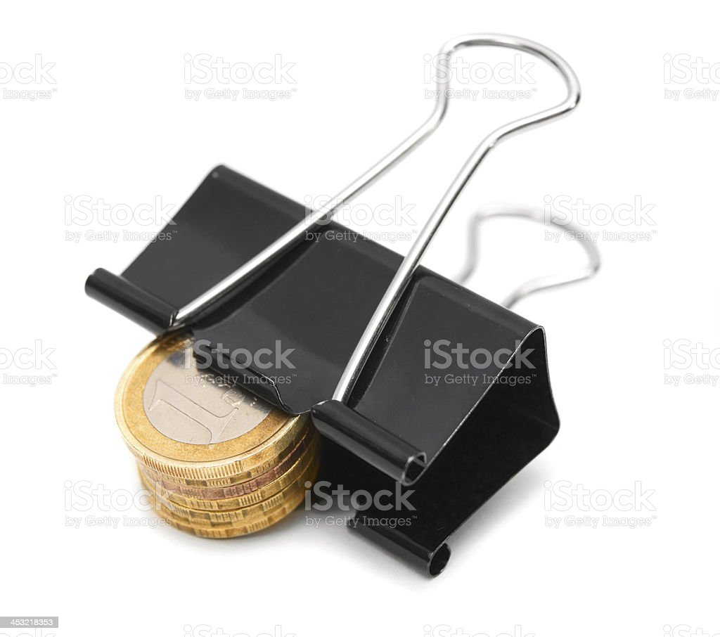 Clip and coins. On a white background. royalty-free stock photo