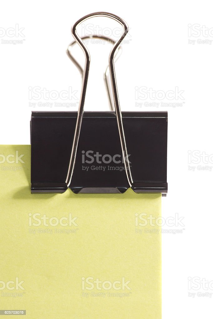 clip and green post-it note isolated on white background stock photo