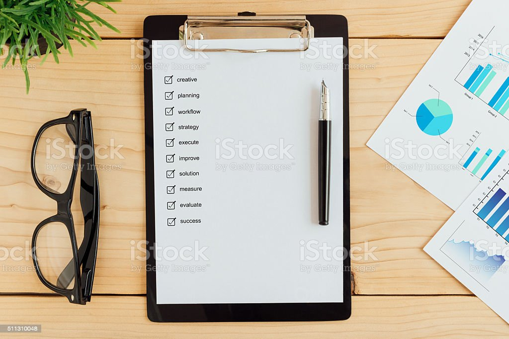 clipboad and check box on work desk business concept stock photo