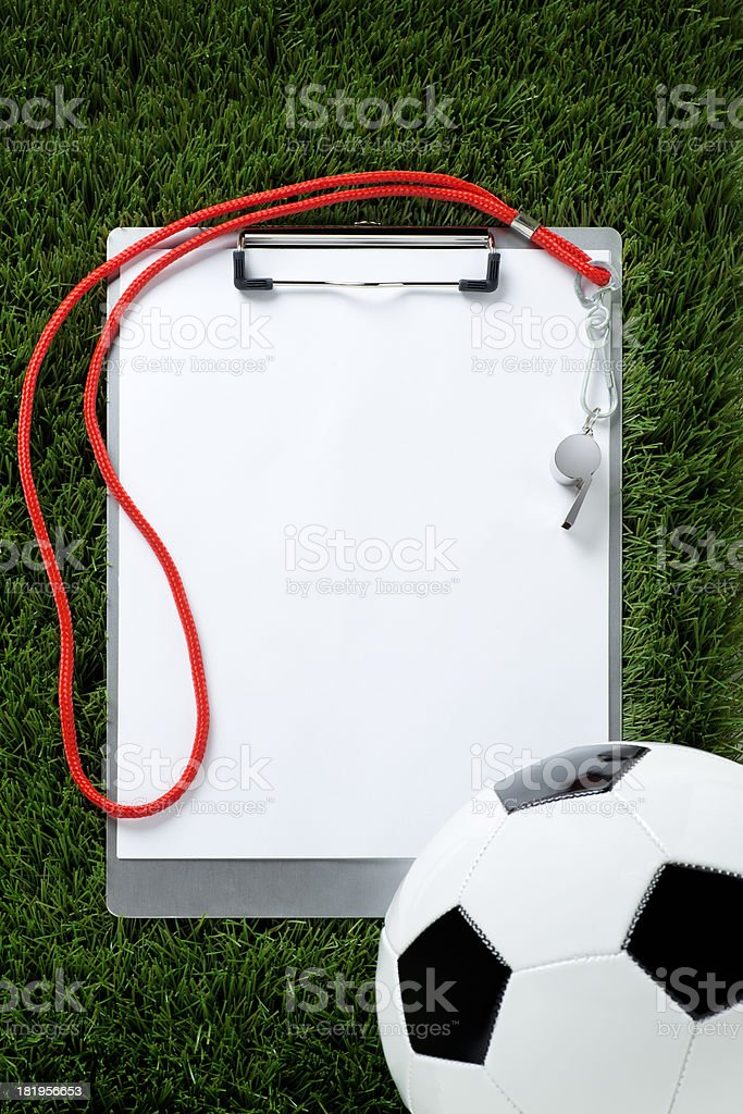 Clipboard and Soccer Ball on Grass royalty-free stock photo
