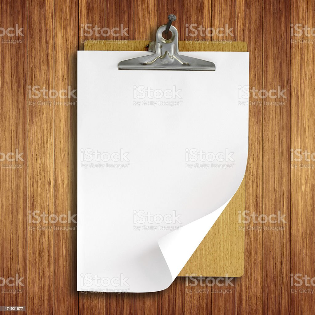clipboard hanging on Wooden wall royalty-free stock photo