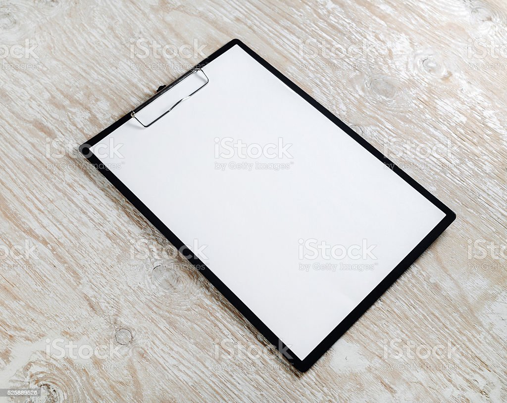 Clipboard with a blank paper stock photo