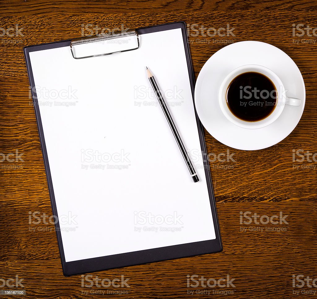 Clipboard with blank page and cup of coffee royalty-free stock photo