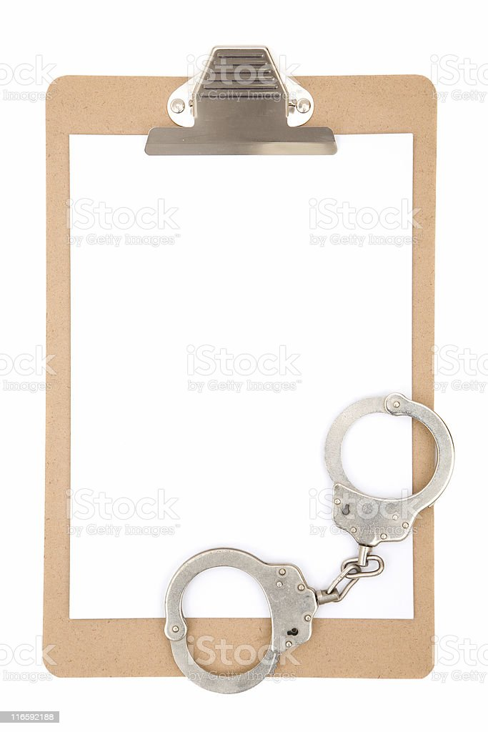 clipboard with handcuffs stock photo