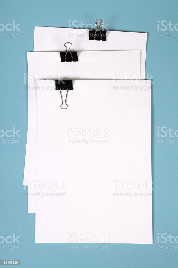 clipboard with squared paper on blue royalty-free stock photo