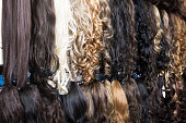 Clip-in hair extensions in wig shop
