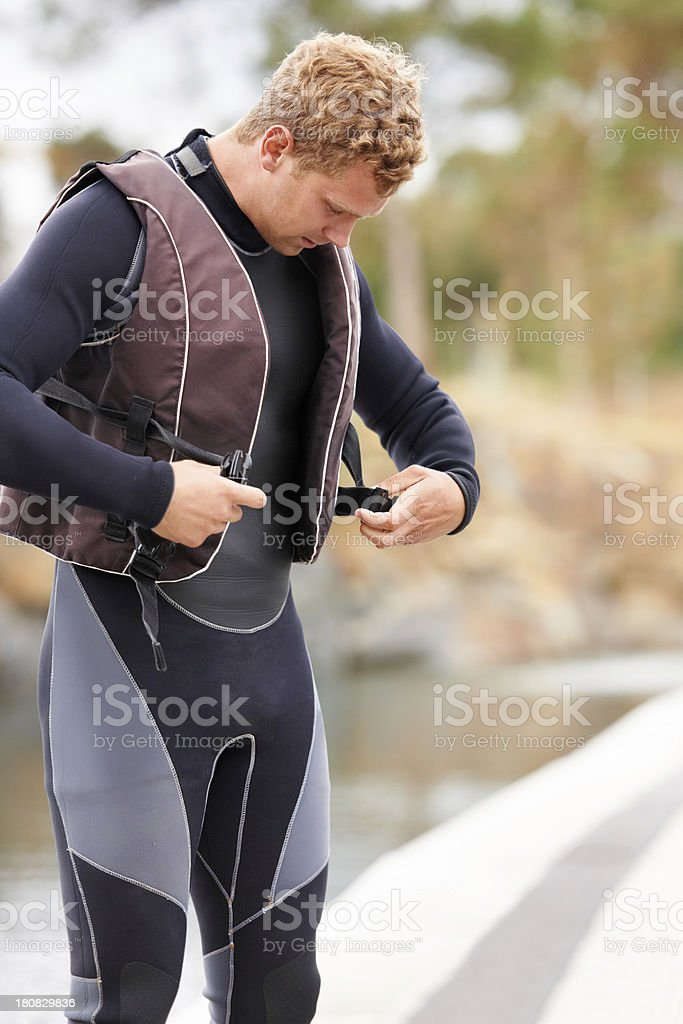 Clipping on his lifevest stock photo