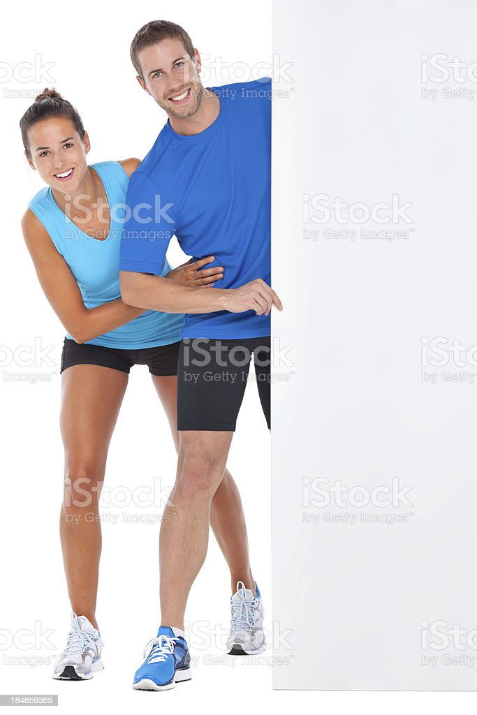 clipping path for board with sporty couple royalty-free stock photo